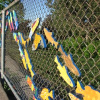 Stream of Dreams fish mural on fence