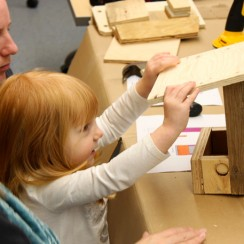 Young girl making a birdhouse at the Watershed Learning Centre