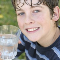 Boy drinking water - Source Water Protection