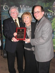 Conservation award winners with plaque