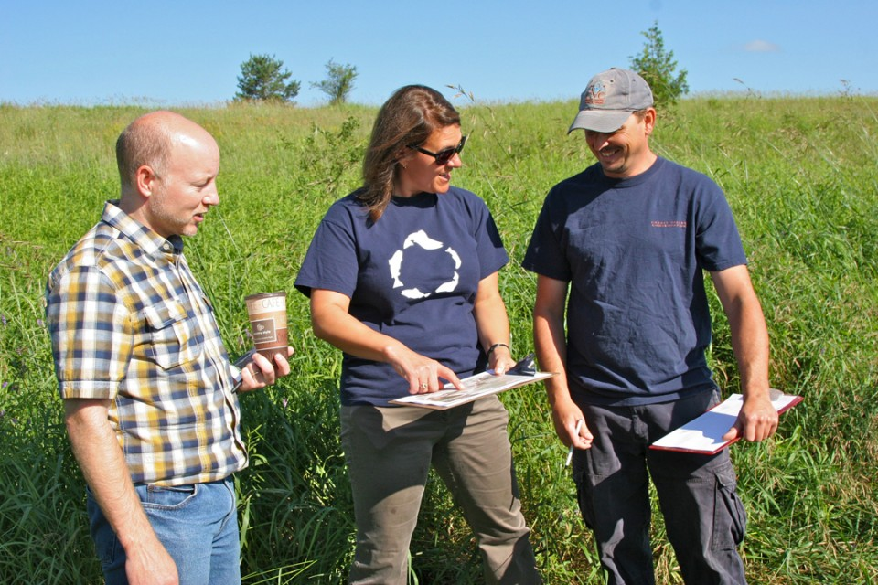 CVC staff discussing plans to restore an old field at Upper Credit Conservation Area.