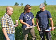 CVC staff discussing field restoration at Upper Credit.