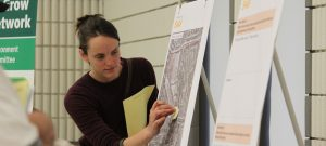 Woman looking at Hungry Hollow Map