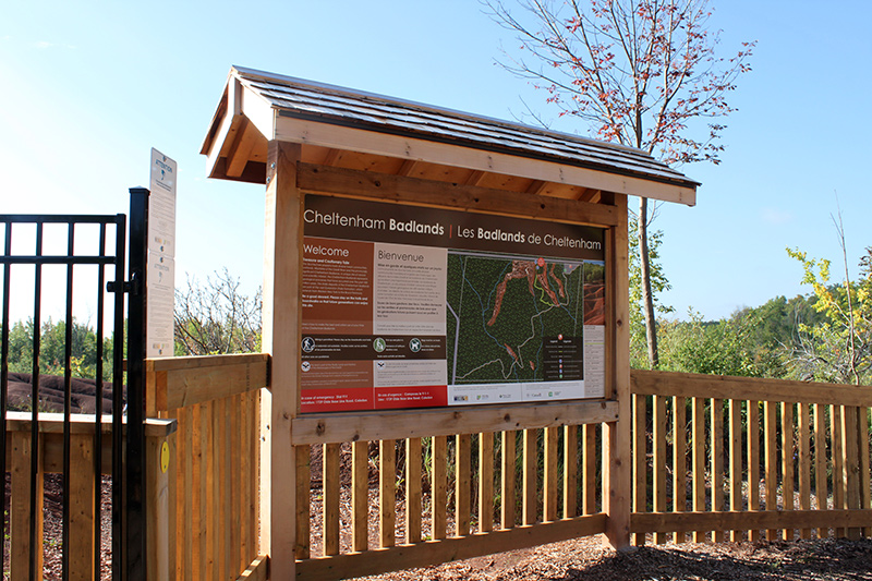 An interpretive sign in a kiosk at the entrance to the viewing platform.