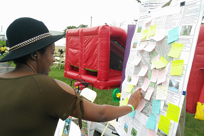 Residents places sticky note on poster board