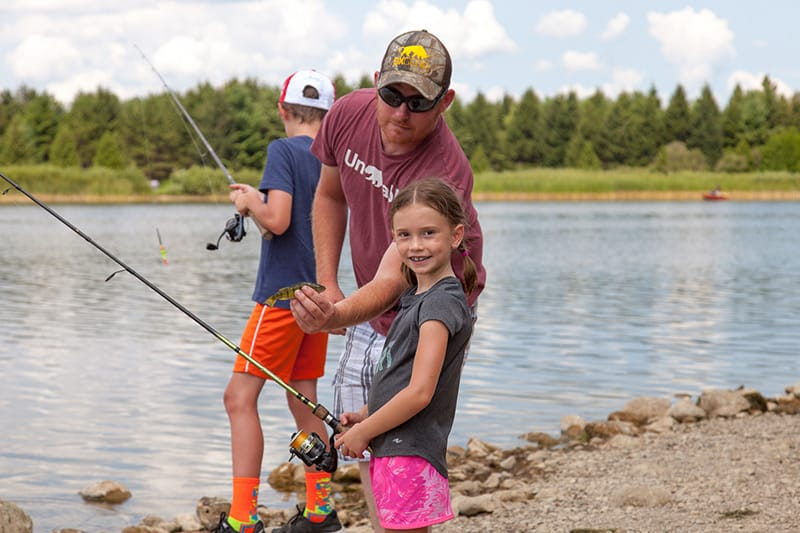 A father, son and daughter fishing together at Island Lake.