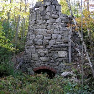 A kiln with a tall wall of stones