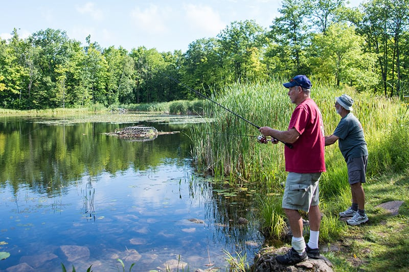 Two men fishing at Terra Cotta Conservation Area.