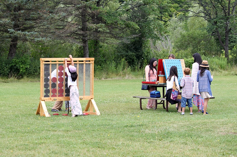 giant games set up in a field with people playing them.