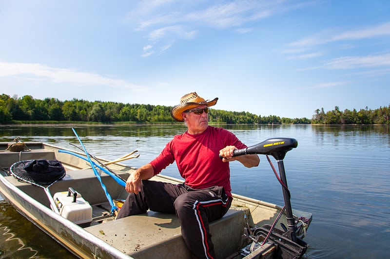 A park visitor in an electric motorboat on Island Lake.