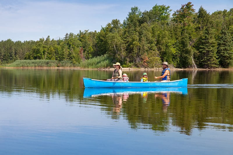 A family canoeing on Island Lake.