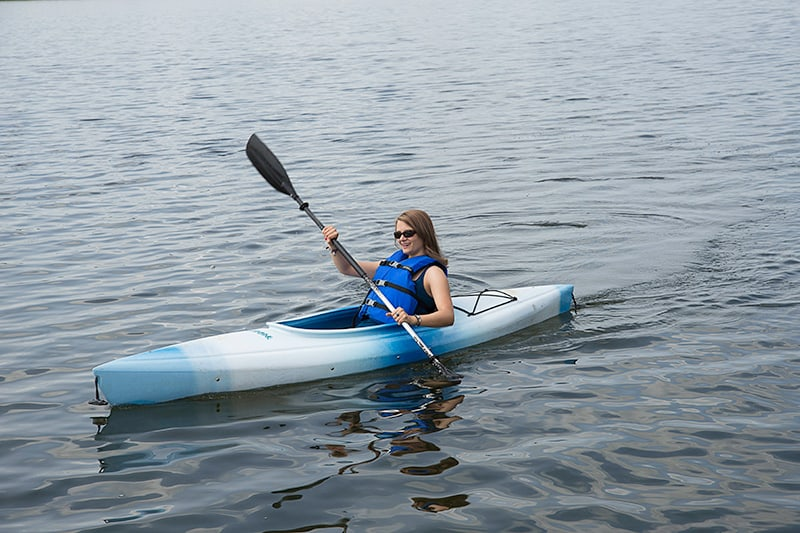 A park visitor in a kayak at Island Lake Conservation Area.