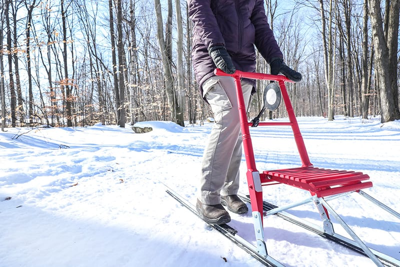 Close-up of a kicksled in use.