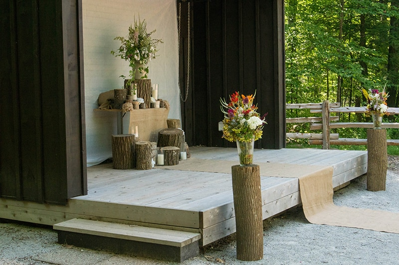 flowers and wedding decor on an outdoor stage