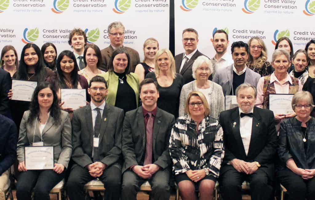 Group of 2019 Conservation Award Winners posing in front of a CVC backdrop.