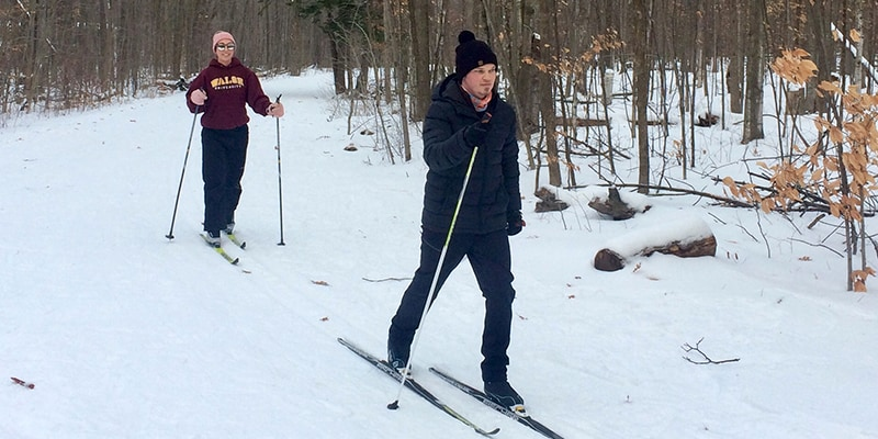 Two park visitors skiing on a trail at Terra Cotta.