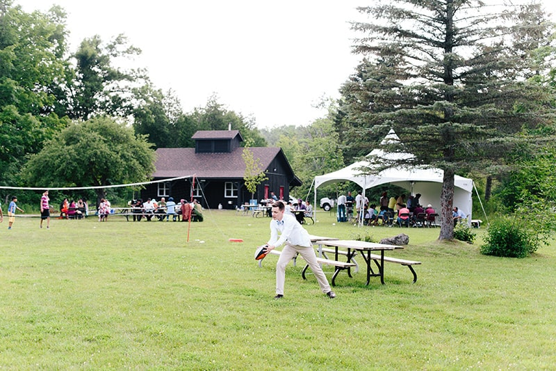 People enjoying the picnic shelter and surrounding grounds at Terra Cotta, playing games.