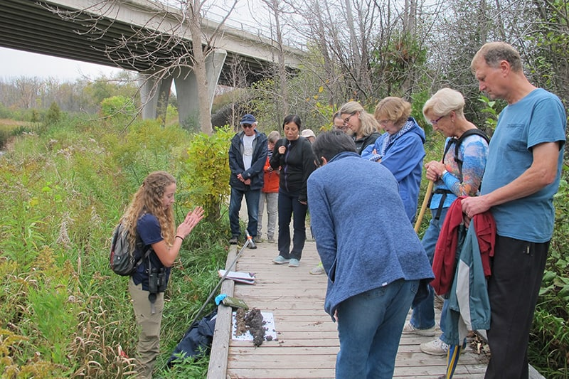 Local residents are learn from CVC staff along a trail