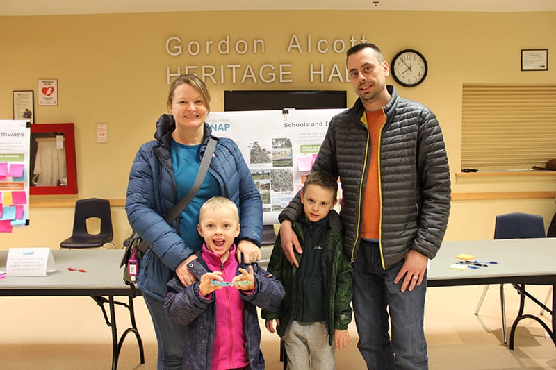 Family posing for picture at open house event