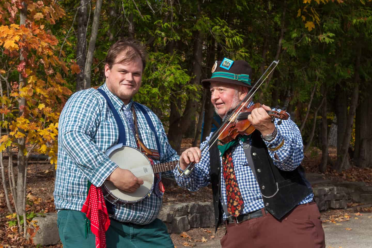 two people paying instruments in the outdoors